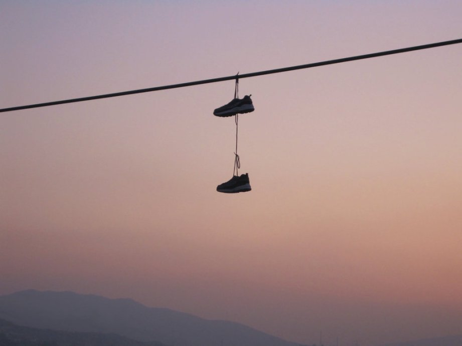 shoes_hanging_from_power_line_by_arimaspy-d4j44xu